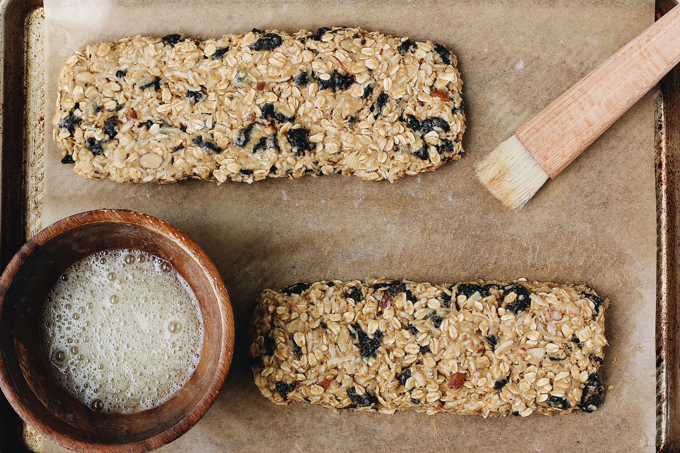 granola-biscotti-egg-wash-before-cutting-shaping
